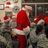 Santa Claus, played by Billy May, greets soldiers at Earl\'s Rib Palace in Moore, Okla., Friday, Dec. 23, 2011. A group of soldiers in basic training at Fort Sill were treated to a day out by the Blue Star Mothers of Oklahoma. Photo by Bryan Terry, The Oklahoman