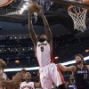 Toronto Raptors\' Amir Johnson (5) claims a defensive rebound in front of Charlotte Bobcats Josh McRoberts, second from right, during second-half NBA basketball game action in Toronto, Friday, March 15 , 2013. (AP Photo/Canadian Press, Chris Young) ORG XMIT: CHY117