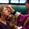 Carol Fairhurst, a member of St. Pius Catholic Church in Coeur d\'Alene, Idaho, receives an ash cross on her forehead from Rev. Francisco Godinez, Wednesday, Feb. 22, 2012 during Ash Wednesday services. Ash Wednesday marks the beginning of the Lent season which lasts 40 days. (AP Photo/Coeur d\'Alene Press, Shawn Gust)