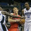 Los Angeles Clippers\' Blake Griffin, center, tries to get off a shot between Orlando Magic\'s Jason Richardson (23) and Dwight Howard (12) during the first half of an NBA basketball game in Orlando, Fla., Tuesday, Feb. 8, 2011.(AP Photo/John Raoux)