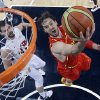 Spain\'s Pau Gasol, right, drives past United States\' Kevin Love, left, to score during the men\'s gold medal basketball game at the 2012 Summer Olympics, Sunday, Aug. 12, 2012, in London. (AP Photo/Eric Gay, pool)