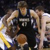 Minnesota Timberwolves\' Andrei Kirilenko (47) loses control of the ball between Golden State Warriors\' Harrison Barnes, left and David Lee during the first half of an NBA basketball game, Tuesday, April 9, 2013, in Oakland, Calif. (AP Photo/George Nikitin)
