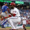 Washington Nationals\' Denard Span is safe at home after the tag was late by New York Mets catcher Anthony Recker during the first inning of a baseball game at Nationals Park Friday, May 16, 2014, in Washington. (AP Photo/Alex Brandon)