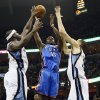 Oklahoma City\'s Reggie Jackson (15) shoots between Memphis\' Zach Randolph (50) and Tayshaun Prince (21) during Game 3 in the second round of the NBA basketball playoffs between the Oklahoma City Thunder and Memphis Grizzles at the FedExForum in Memphis, Tenn., Saturday, May 11, 2013. Photo by Nate Billings, The Oklahoman
