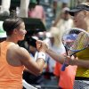 Maria Sharapova, of Russia, right, shakes hands with Kirsten Flipkens, of Belgium, after winning 3-6, 6-4, 6-1 at the Sony Open tennis tournament, Monday, March 24, 2014, in Key Biscayne, Fla. (AP Photo/Lynne Sladky)