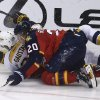 Photo - Nashville Predators' Paul Gaustad (28) and Florida Panthers Sean Bergnheim (20) fall to the ice as they chase the puck during the second period of a NHL hockey game in Sunrise, Fla., Saturday, Jan. 4, 2014. (AP Photo/J Pat Carter)