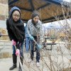 Sonia Patel, left, and Audrea Munoz rake debris from a planting bed during the UCO Big Event Day at Douglas Park in Oklahoma City.