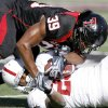 Texas Tech\'s Maron Williams brings down OU\'s Chris Brown during the college football game between the University of Oklahoma Sooners (OU) and Texas Tech University Red Raiders (TTU ) at Jones AT&T Stadium in Lubbock, Texas, Saturday, Nov. 21, 2009. Photo by Bryan Terry, The Oklahoman