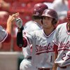 Photo - Stanford's Alex Blandino is congratulated by teammates after he scored in the first inning against Indiana State during an NCAA college baseball tournament regional game Friday, May 30, 2014, in Bloomington, Ind. (AP Photo/Tribune-Star, Joseph C. Garza)