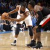 Oklahoma City\'s James Harden (13) looks to get by Portland\'s Gerald Wallace (3) during the NBA game between the Oklahoma City Thunder and the Portland Trailblazers, Sunday, March 27, 2011, at the Oklahoma City Arena. Photo by Sarah Phipps, The Oklahoman