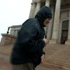Daniel Stockton, a UCO student, tries to keep dry as he walks to the state Capitol in Oklahoma City on Wednesday, April 29, 2009. Photo by John Clanton