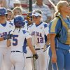 Florida\'s Kim Waleszonia (5) is met by her teammates behind UCLA catcher Jennifer Schroeder (27) after Waleszonia scored in the first inning during the softball game in the Women\'s College World Series between UCLA and Florida at ASA Hall of Fame Stadium in Oklahoma City, Saturday, May 31, 2008. BY NATE BILLINGS, THE OKLAHOMAN