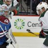 Photo - Colorado Avalanche goalie Semyon Varlamov (1), from Russia, blocks a shot by Minnesota Wild center Charlie Coyle (3) during the second period of an NHL hockey game on Saturday, Nov. 30, 2013, in Denver. (AP Photo/Jack Dempsey)