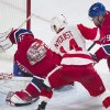 Photo - Montreal Canadiens goaltender Carey Price left, makes a save against Detroit Red Wings' Gustav Nyquist, center, as Canadiens' Andrei Markov during the second period of an NHL hockey game in Montreal, Saturday, April 5, 2014. (AP Photo/The Canadian Press, Graham Hughes)