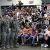 Families and soldiers wait for the speeches to be over so that can greet each other during the return ceremony for the National Guard\'s 45th Infantry Brigade Combat Team at the Army Aviation hanger at Will Rogers Air National Guard Base Sunday, March 25th, 2012. PHOTO BY HUGH SCOTT, FOR THE OKLAHOMAN