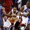 Miami\'s Chris Bosh (1) works between Oklahoma City\'s James Harden (13) and Kendrick Perkins (5) during Game 3 of the NBA Finals between the Oklahoma City Thunder and the Miami Heat at American Airlines Arena, Sunday, June 17, 2012. Photo by Bryan Terry, The Oklahoman