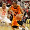 Oklahoma State\'s Markel Brown (22) drives against Texas Tech\'s Toddrick Gotcher (20) during their NCAA college basketball game, Wednesday, Feb. 13, 2013, in Lubbock, Texas. (AP Photo/The Avalanche-Journal, Zach Long) ALL LOCAL TV OUT