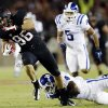 Photo -   Stanford tight end Zach Ertz, left, is tackled by Duke safety Walt Canty after a 43-yard reception during the first half of an NCAA college football game in Stanford, Calif., Saturday, Sept. 8, 2012. (AP Photo/Marcio Jose Sanchez)