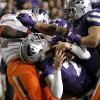 Oklahoma State\'s Calvin Barnett (99) gets the face mask of Kansas State\'s Collin Klein (7) during the college football game between the Oklahoma State University Cowboys (OSU) and the Kansas State University Wildcats (KSU) at Bill Snyder Family Football Stadium on Saturday, Nov. 1, 2012, in Manhattan, Kan. Photo by Chris Landsberger, The Oklahoman