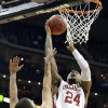 Oklahoma\'s Romero Osby shoots over Iowa State\'s George Niang during the Phillips 66 Bug 12 Men\'s basketball championship tournament game between the University of Oklahoma and Iowa State at the Sprint Center in Kansas City, Thursday, March 14, 2013. Photo by Sarah Phipps, The Oklahoman