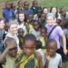 Oklahoma Christian University students pose with young villagers during a mission trip to Tanzania, Africa. Photo provided.