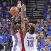 Oklahoma City\'s Serge Ibaka (9) and Oklahoma City\'s James Harden (13) defend on Miami\'s Chris Bosh (1) during Game 1 of the NBA Finals between the Oklahoma City Thunder and the Miami Heat at Chesapeake Energy Arena in Oklahoma City, Tuesday, June 12, 2012. Photo by Chris Landsberger, The Oklahoman