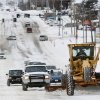 A plow clears snow from Vandament Avenue in Yukon, Thursday December 6, 2013. Photo By Steve Gooch, The Oklahoman