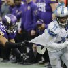 Photo - Detroit Lions wide receiver Kevin Ogletree (11) runs from Minnesota Vikings cornerback Shaun Prater after making a reception during the second half of an NFL football game, Sunday, Dec. 29, 2013, in Minneapolis. (AP Photo/Ann Heisenfelt)