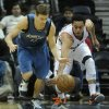 Photo - Minnesota Timberwolves point guard Luke Ridnour (13), left,  and Atlanta Hawks guard John Jenkins (12) race for the ball during the first half on an NBA basketball game in Atlanta, Monday, Jan. 21, 2013. (AP Photo/John Amis)