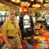 FILE - In this Aug. 24, 2013 file photo, Black Oak Casino general manager Ron Patel walks the nearly empty gambling room floor due to the nearby fires in Tuolomne City, Calif. It doesn\'t pay to be a dateline in a disaster story, as the folks around Groveland, Calif. will tell you. On what would have been the busiest weekend of the summer had the Strawberry Music Festival not been cancelled, hotel rooms are empty and the local coffee roaster got rid of all 6 employees because the road to Yosemite is closed. One hotelier has had $20,000 in cancellations just this week. In the park, tourists are enjoying elbow room as hard-to-get campsite and lodging rooms are full but day tourists are staying away out of fear of fire and smoke. (AP Photo/The Modesto Bee, Elias Funez, File)