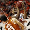 Oklahoma State\'s Le\'Bryan Nash (2) collides with Texas\' Ioannis Papapetrou (33) during a men\'s college basketball game between Oklahoma State University and the University of Texas at Gallagher-Iba Arena in Stillwater, Okla., Saturday, March 2, 2013. Nash was called for a foul on the play. OSU won, 78-65. Photo by Nate Billings, The Oklahoman