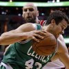 Photo - Boston Celtics center Kris Humphries (43) drives past Washington Wizards center Marcin Gortat (4), from Poland, in the first half of an NBA basketball game, Wednesday, Jan. 22, 2014, in Washington. (AP Photo/Alex Brandon)