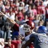 OU\'s Blake Bell (10) throws a touchdown pass as he is pressured by KU\'s Ben Goodman (93) during of the college football game between the University of Oklahoma Sooners (OU) and the University of Kansas Jayhawks (KU) at Memorial Stadium in Lawrence, Kan., Saturday, Oct. 19, 2013. OU won 34-19. Photo by Sarah Phipps, The Oklahoman