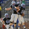 Guthrie\'s Luke Davis, at right, celebrates with Blake Belcher, center, as John Clark watches after Davis scored a touchdown against Durant in the first round of the Class 5A high school football playoffs in Guthrie, Okla., Saturday, Nov. 12, 2011. Photo by Bryan Terry, The Oklahoman