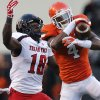 Oklahoma State\'s Justin Gilbert (4) breaks up a pass to Texas Tech\'s Eric Ward (18) during the college football game between the Oklahoma State University Cowboys (OSU) and Texas Tech University Red Raiders (TTU) at Boone Pickens Stadium on Saturday, Nov. 17, 2012, in Stillwater, Okla. Photo by Chris Landsberger, The Oklahoman
