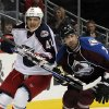 Columbus Blue Jackets center Artem Anisimov (42), from Russia, and Colorado Avalanche defenseman Ryan O\'Byrne (3) look on during the second period of an NHL hockey game on Thursday, Jan. 24, 2013, in Denver. (AP Photo/Jack Dempsey)