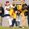 West Virginia\'s Brodrick Jenkins (23) intercepts a pass over Oklahoma\'s Kenny Stills (4) during the third quarter of their NCAA college football game against Oklahoma in Morgantown, W.Va., on Saturday, Nov. 17, 2012. Oklahoma won 50-49. (AP Photo/Christopher Jackson)