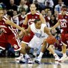 North Carolina\'s Wayne Ellington (22) gets past the defense of Oklahoma\'s Omar Leary (11) and Austin Johnson (20) during the first half in the Elite Eight game of NCAA Men\'s Basketball Regional between the University of North Carolina and the University of Oklahoma at the FedEx Forum on Sunday, March 29, 2009, in Memphis, Tenn. PHOTO BY CHRIS LANDSBERGER, THE OKLAHOMAN