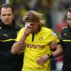 Dortmund\'s Marcel Schmelzer, center, is helped to leave the pitch after an injury during the German Bundesliga soccer match between VfB Stuttgart and Borussia Dortmund, in Stuttgart, southern Germany Saturday March 30, 2013. ( (AP Photo/dpa, Marijan Murat)