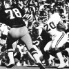 University of Oklahoma running back Billy Sims gets past Colorado defender George Visger for short yardage as the Sooners went on to beat the Buffalos, 28-7, in Boulder. Staff photo by Jim Argo taken 11/4/78.