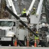 A utility crew works on damaged power lines in Little Rock, Ark., Friday, Dec. 28, 2012, in the wake of a Christmas day winter storm leaving thousands without electric power. (AP Photo/Danny Johnston)