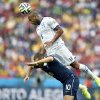 Honduras\' Victor Bernardez leaps over France\'s Karim Benzema to head the ball during the group E World Cup soccer match between France and Honduras at the Estadio Beira-Rio in Porto Alegre, Brazil, Sunday, June 15, 2014. (AP Photo/Martin Meissner)