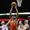 Milwaukee Bucks\' Larry Sanders (8) scores against Phoenix Suns\' Jared Dudley (3), Marcin Gortat, right, of Poland, and Luis Scola, of Argentina, in the first half during an NBA basketball game on Thursday, Jan. 17, 2013, in Phoenix. (AP Photo/Ross D. Franklin)