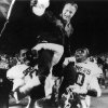 OU head college football coach Barry Switzer is carried off the field on the shoulders of Billy Dykes, left, and Chris Wilson after defeating OSU on Saturday, Nov 5, 1988 in the Bedlam college football game. Staff photo by David McDaniel