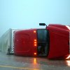 EL RENO, OK - An overturned semi rests on its side on the eastbound lanes of I-40, just east of el Reno, OK., after a tornado touched down Friday, May 31, 2013. CHRIS MACHIAN/THE WORLD-HERALD