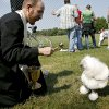 BLESS / BLESSING: The Rev. John Lock, of All Souls\' Episcopal Church, blesses a dog named Butler during the 13th annual Nichols Hills Pooch Parade at Grand Park in Nichols Hills on Sunday, Sept. 20, 2009. By John Clanton, The Oklahoman ORG XMIT: KOD