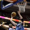 Minnesota Timberwolves\' Kevin Love (42) shoots against Philadelphia 76ers\' Lavoy Allen (50) in the first half of an NBA basketball game, Tuesday, Dec. 4, 2012, in Philadelphia. (AP Photo/Matt Slocum)