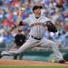 Photo - San Francisco Giants starting pitcher Tim Hudson throws in the first inning during a baseball game against the Kansas City Royals, Saturday, Aug. 9, 2014, in Kansas City, Mo. (AP Photo/Ed Zurga)