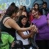 Three voters take pictures of their inked thumbs with a cell phone after voting in the presidential election at a polling station in the 23 de Enero neighborhood of Caracas, Venezuela, Sunday, Oct. 7, 2012. President Hugo Chavez is running for re-election against opposition candidate Henrique Capriles. (AP Photo/Rodrigo Abd)