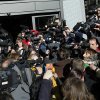 Press gather as a member of the Popular Party arrives to the emergency meeting outside the Popular Party\'s headquarter in Madrid, Spain, Saturday, Feb. 2, 2013. Spain\'s governing Popular Party insists its financial accounts are totally legal and denies a newspaper report of regular under-the-table payments to leading members, including current Prime Minister Mariano Rajoy. The scandal first broke when after the National Court reported that former party treasurer Luis Barcenas amassed an unexplained euro 22 million ($30 million) in a Swiss bank account several years ago. (AP Photo/Andres Kudacki)